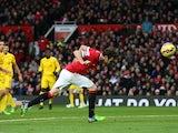 Manchester United's Juan Mata scores against Liverpool on December 14, 2014