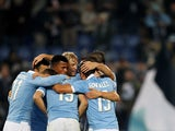 Senad Lulic #19 with his teammates of SS Lazio celebrates after scoring the third team's goal during the Serie A match between SS Lazio and Atalanta BC at Stadio Olimpico on December 13, 2014