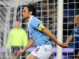 Stefano Mauri of SS Lazio celebrates after scoring the opening goal during the Serie A match between SS Lazio and Atalanta BC at Stadio Olimpico on December 13, 2014