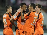 Lorient's Ghanaian forward Jordan Ayew celebrates with his teammates after scoring a goal during the French L1 football match between Lorient (FCL) and Metz (FCM) on December 13, 2014