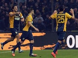 Luca Toni (L) of Hellas Verona celebrates after scoring his team's first goal during the Serie A match against Udinese Calcio on December 14, 2014