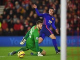 Robin van Persie of Manchester United scores past Fraser Forster of Southampton for the opening goal during the Barclays Premier League match between Southampton and Manchester United at St Mary's Stadium on December 8, 2014