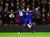 Robin van Persie of Manchester United celebrates scoring the opening goal during the Barclays Premier League match between Southampton and Manchester United at St Mary's Stadium on December 8, 2014