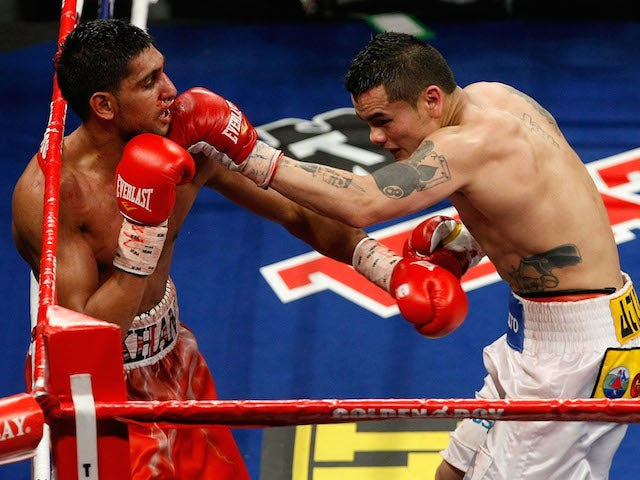 Marcos Maidana of Argentina connects with a left at Amir Khan of England during the WBA super lightweight title fight at Mandalay Bay Events Center on December 11, 2010