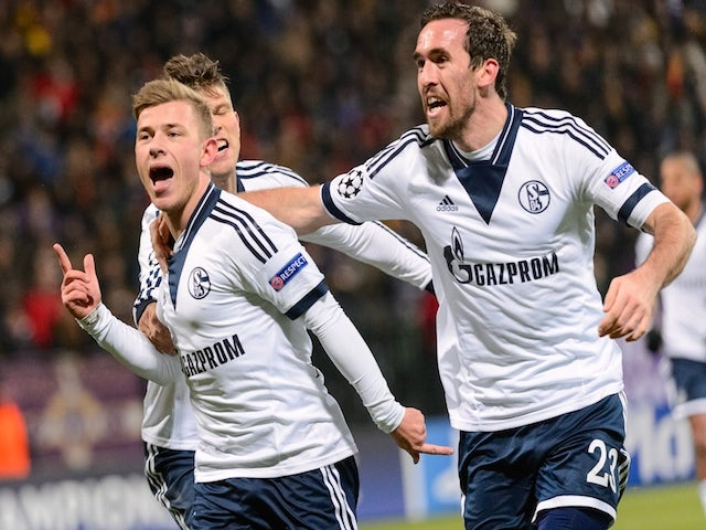 Schalke's midfielder Max Meyer (L) celebrates with defender Christian Fuchs (R) after scoring a goal during the UEFA Champions League Group G football match against NK Maribor on December 10, 2014