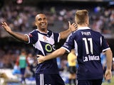 Archie Thompson of Victory celebrates after scoring a goal during the round 11 A-League match between Melbourne Victory and Sydney FC at Etihad Stadium on December 13, 2014