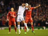 Mohamed Elneny of FC Basel and Joe Allen of Liverpool compete for a header during the UEFA Champions League group B match on December 9, 2014