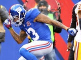 Odell Beckham Jr. #13 of the New York Giants celebrates after scoring 10 yard touchdown thrown by Eli Manning #10 in the first quarter against the Washington Redskins during their game at MetLife Stadium on December 14, 2014