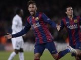 Barcelona's Brazilian forward Neymar da Silva Santos Junior celebrates his goal during the UEFA Champions League Group F football match against PSG on December 10, 2014