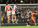 Arsenal's French striker Olivier Giroud (C) rises highest to head the ball to score the opening goal during the English Premier League football match against Newcastle United on December 13, 2014
