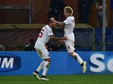 Roma's midfielder from Belgium Radja Nianggolan (L) celebrates with Roma's defender from Greece Jose Holebas after scoring during the Italian Serie A football match against Genoa on December 14, 2014