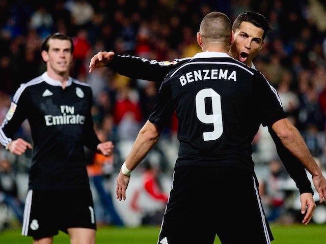 Gareth Bale, Karim Benzema and Cristiano Ronaldo celebrate Real Madrid's third goal during the La Liga match against Almeria on December 12, 2014