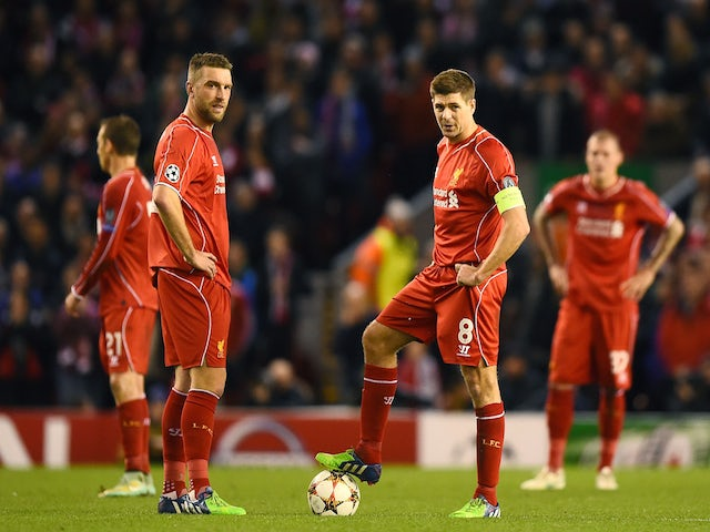 Dejected Liverpool players Rickie Lambert and Steven Gerrard look on after conceding the opening goal during the UEFA Champions League group B match against Basel on December 9, 2014