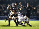 Alistair Hargreaves of Saracens takes on the Sale Sharks defence during the European Rugby Champions Cup match between Saracens and Sale Sharks at Allianz Park on December 13, 2014