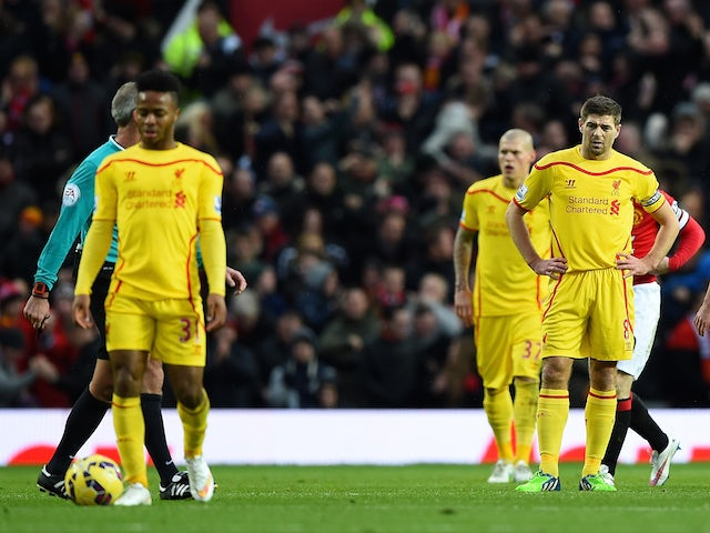 Steven Gerrard and teammates look dejected after Manchester United's second goal during the Premier League match on December 14, 2014