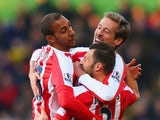 Peter Crouch of Stoke City celebrates with team mates Steven N'Zonzi and Erik Pieters as he scores their first goal during the Barclays Premier League match between Crystal Palace and Stoke City at Selhurst Park on December 13, 2014