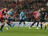 Jordi Gomez #14 of Sunderland scores the opening goal from the penalty spot during the Barclays Premier League match between Sunderland and West Ham United at Stadium of Light on December 13, 2014