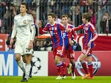 Bayern Munich's midfielder Thomas Mueller celebrates scoring a penalty during the UEFA Champions League Group E second-leg football match against CSKA Moscow on December 10, 2014