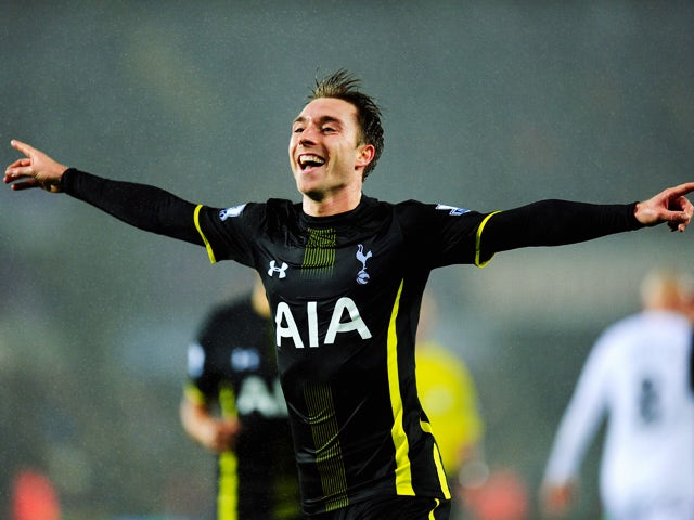 Spurs player Christian Eriksen celebrates after scoring the second Spurs goal during the Barclays Premier League match between Swansea City and Tottenham Hotspur at Liberty Stadium on December 14, 2014