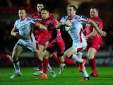 Darren Cave of Ulster breaks through to go over for his side's first try during the European Rugby Champions Cup match between Scarlets and Ulster Rugby at Parc y Scarlets on December 14, 2014