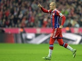 Bayern Munich's Dutch midfielder Arjen Robben celebrates scoring the 1-0 goal during the German first division Bundesliga football match against SC Freiburg on December 16, 2014