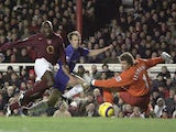 Arjen Robben of Chelsea slides the ball into the goal as Jens Lehmann and Sol Campbell of Arsenal can only look on during the Barclays Premiership match on December 18, 2005