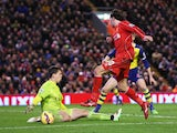 Lazar Markovic of Liverpool has his shot saved by Wojciech Szczesny of Arsenal during the Barclays Premier League match between Liverpool and Arsenal at Anfield on December 21, 2014