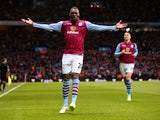 Christian Benteke of Aston Villa celebrates scoring the opening goal during the Barclays Premier League match between Aston Villa and Manchester United at Villa Park on December 20, 2014