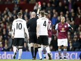 Referee shows the red card to Aston Villa's English striker Gabriel Agbonlahor (R) during the English Premier League football match between Aston Villa and Manchester United at Villa Park in Birmingham, central England, on December 20, 2014