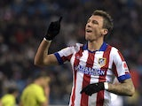 Atletico Madrid's Croatian forward Mario Mandzukic celebrates after scoring during the Spanish Copa del Rey (King's Cup) round of 32 second leg football match Club Atletico de Madrid vs CE L'Hospitalet at the Vicente Calderon stadium in Madrid on December