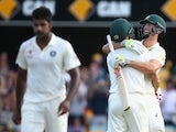Mitch Marsh of Australia and Mitchell Johnson of Australia embrace as Marsh hits the winning runs to win the test during day four of the 2nd Test match between Australia and India at The Gabba on December 20, 2014