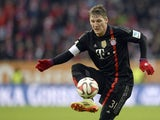 Bayern Munich's midfielder Bastian Schweinsteiger plays the ball during the German First division Bundesliga football match FC Augsburg vs FC Bayern Muenchen in Augsburg, southern Germany, on December 13, 2014