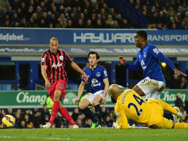 Queens Park Rangers' English striker Bobby Zamora (L) scores QPR's first goal during the English Premier League football match against Everton on December 15, 2014