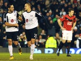 Fulham's USA player Clint Dempsey (L) congratulates Fulham's English striker Bobby Zamora (R) after he scores the second goal during the English Premier League football match on December 19, 2009