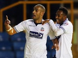 Darren Pratley of Bolton Wanderers celebrates scoring with team mate Rob Hall during the Sky Bet Championship match against Millwall on December 19, 2014