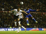 Didier Drogba of Chelsea jumps for a header with Jake Buxton of Derby during the Capital One Cup Quarter-Final match against Derby County on December 16, 2014