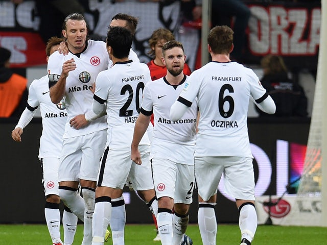 Frankfurt's midfielder Alexander Meier celebrates with teammates after scoring during German first division Bundesliga football match Bayer 04 Leverkusen vs Eintracht Frankfurt at the BayArena in Leverkusen, western Germany on December 20, 2014