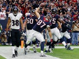 C.J. Fiedorowicz #87 of the Houston Texans spikes the ball in front of Rashaan Melvin #38 of the Baltimore Ravens after scoring a second-half touchdown during their game at NRG Stadium on December 21, 2014