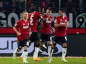 Hannover's Spanish striker Joselu (3rd L) celebrates after scoring his team's second goal with Maurice Hirsch and Salif Sane on December 16, 2014