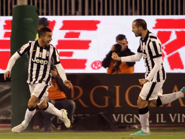 Carlos Tevez of Juventus celebrates the goal 0-1 during the Serie A match betweeen Cagliari Calcio and Juventus FC at Stadio Sant'Elia on December 18, 2014