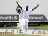 West Indies bowler Kemar Roach unsuccesfully appeals for the wicket of South African batsman AB De Villiers during the first day of the First test match between South Africa and the West Indies at the Supersport Park in Centurion on December 17, 2014
