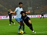 Lazio's midfielder Marco Parolo fights for the ball with Inter Milan's defender from Brazil Dodo during their Serie A football match Inter Milan vs Lazio at San Siro Stadium in Milan on December 21, 2014