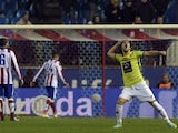 Hospitalet's midfielder Alex Barrera celebrates a goal's teammate during the Spanish Copa del Rey (King's Cup) round of 32 second leg football match Club Atletico de Madrid vs CE L'Hospitalet at the Vicente Calderon stadium in Madrid on December 18, 2014
