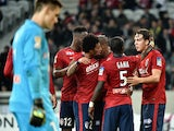 Lille's Swiss forward Michael Frey is congratulated by teammates after scoring during the French League Cup football match Lille vs Bordeaux on December 17, 2014