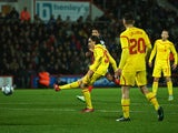 Lazar Markovic of Liverpool scores his team's second goal during the Capital One Cup Quarter-Final match between Bournemouth and Liverpool at Goldsands Stadium on December 17, 2014