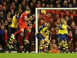 Martin Skrtel of Liverpool heads the equalising goal during the Barclays Premier League match between Liverpool and Arsenal at Anfield on December 21, 2014
