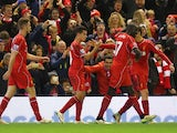 Philippe Coutinho of Liverpool celebrates his goal with team mates during the Barclays Premier League match between Liverpool and Arsenal at Anfield on December 21, 2014