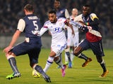 Bordeaux's Senegalese defender Ludovic Sane vies with Lyon's French forward Alexandre Lacazette during the French L1 football match between Girondins de Bordeaux (FCGB) and Lyon (OL) on December 21, 2014