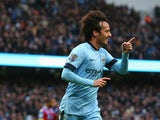 David Silva of Manchester City celebrates scoring his team's second goal during the Barclays Premier League match between Manchester City and Crystal Palace at Etihad Stadium on December 20, 2014