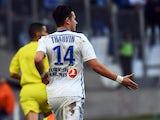 Marseille's French midfielder Florian Thauvin gestures after scoring a goal during the French L1 football match Marseille (OM) vs Lille (LOSC) on December 21, 2014